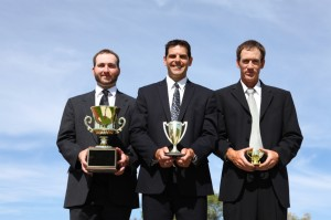 Businessmen with trophies